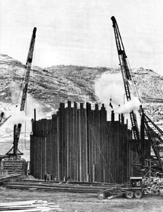 GIANT COFFERDAM of sheet steel piling being built to divert the Columbia River