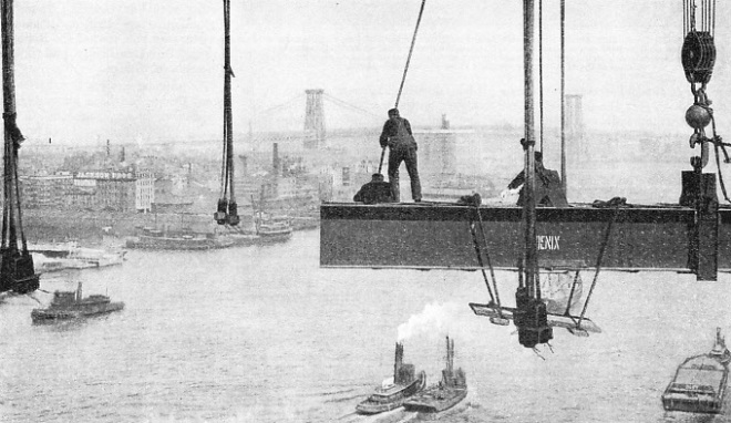 Men bolted the girders of the deck to the vertical stays of Manhattan Bridge