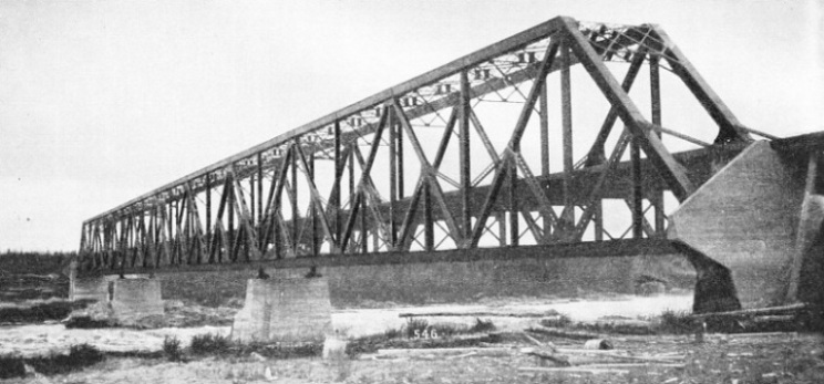 A substantial steel girder structure carries the Hudson Bay Railway across the Nelson River at Kettle Rapids