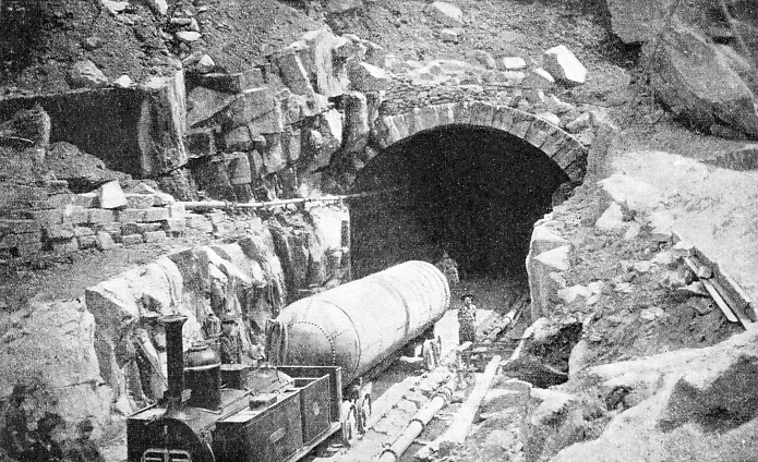 WORK AT THE ENTRANCE to the St. Gotthard Tunnel