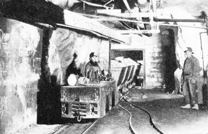 Car Loads of Gold-Bearing Ore Hauled by Electric Trolley