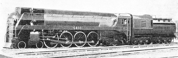 EIGHT COUPLED WHEELS and leading and trailing bogies give No. 6400 the 4-8-4 wheel arrangement