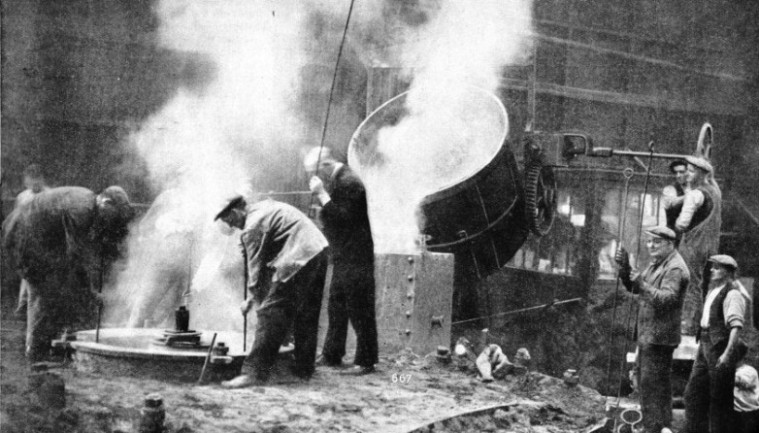 POURING MOLTEN BRONZE into the mould of one of the Queen Mary's propellers