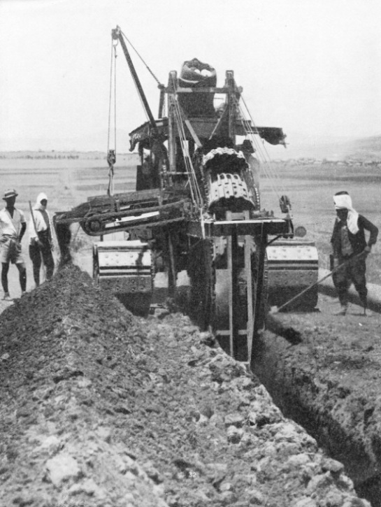 A DITCHING MACHINE AT WORK on the Iraq pipe line