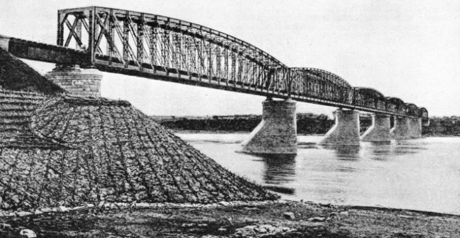SIX STEEL SPANS carry the Trans-Siberian Railway across the River Tom