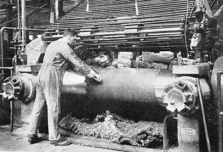 MASTICATING MILL in which raw rubber is worked between large steel rollers